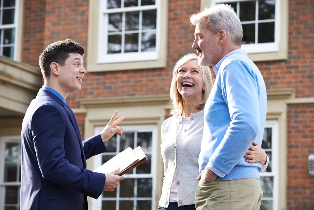 Senior Couple meeting with a realtor