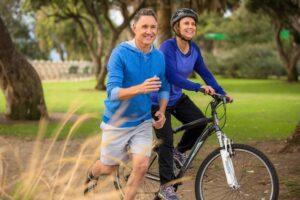 Senior couple running and biking