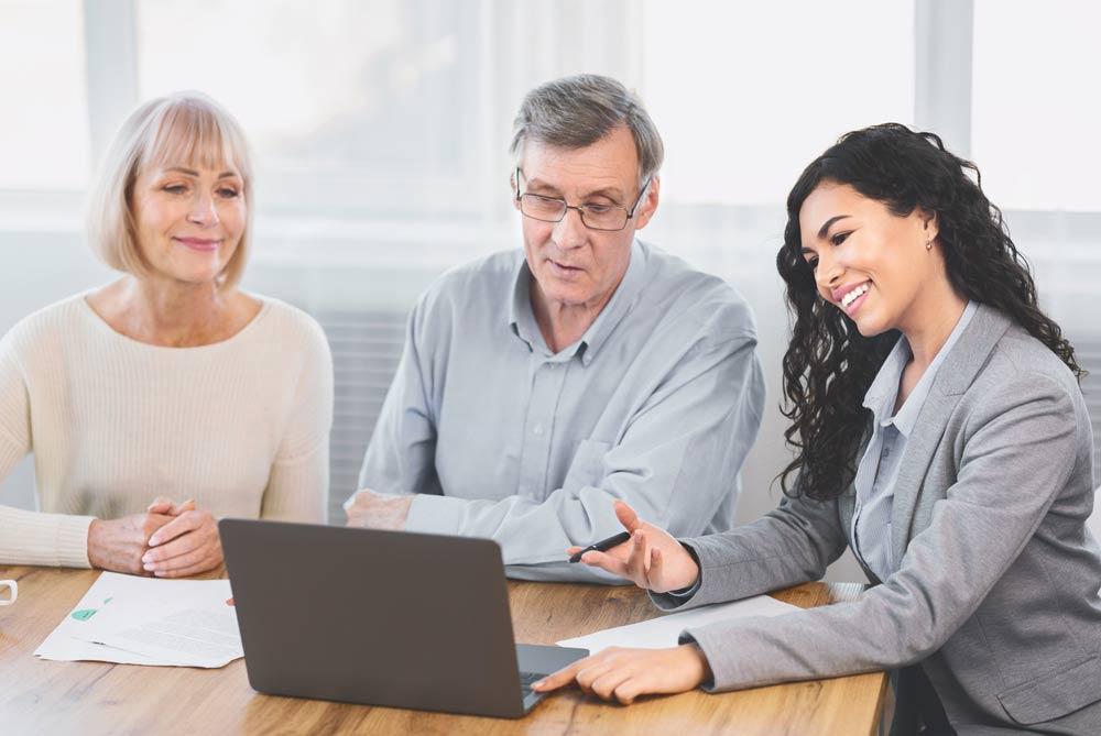 Senior couple meeting with a financial advisor