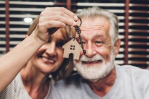 Couple holding home keychain