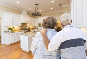 Senior Couple looking at kitchen, getting ready to sell their home
